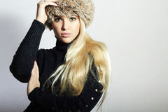 Beautiful Young Woman in Fur Hat. Pretty Blond Girl. Winter Fashion Beauty Royalty Free Stock Photo