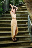 Beautiful young woman in a garden stairs. Royalty Free Stock Images