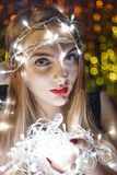 Beautiful young woman with garlands on face and body Royalty Free Stock Photography