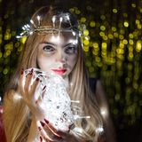 Beautiful young woman with garlands on face and body Royalty Free Stock Photo