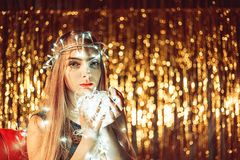 Beautiful young woman with garlands on face and body Stock Photos