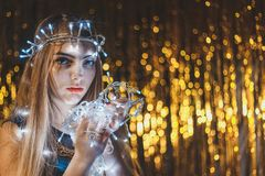 Beautiful young woman with garlands on face and body Royalty Free Stock Photos