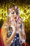 Beautiful young woman with garlands on face and body Royalty Free Stock Images