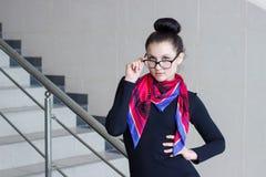 Beautiful young woman gazing glasses Stock Image