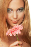 Beautiful young woman with gerber flower Stock Photography