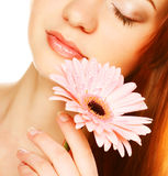 Beautiful young woman with gerber flower Stock Images
