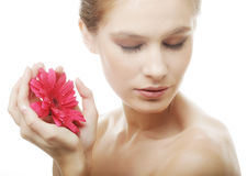 Beautiful young woman with gerber flower Royalty Free Stock Image