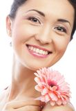 Beautiful young woman with gerber flower Stock Photo