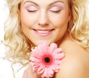 Beautiful young woman with gerber flower Royalty Free Stock Photography