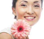 Beautiful young woman with gerber flower Royalty Free Stock Photos
