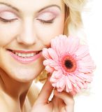 Beautiful young woman with gerber flower Royalty Free Stock Photo