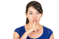 Beautiful young woman gesturing silence shhh with. Closeup of beautiful young woman gesturing silence shhh with finger on mouth isolated on white Royalty Free Stock Photography