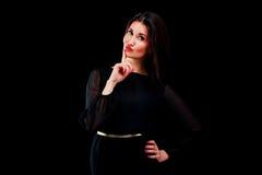Beautiful young woman gesturing silence. Studio shot Stock Photos