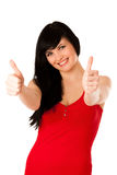 Beautiful young woman gesturing success showing thumb up Stock Images