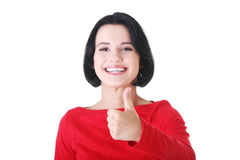 Beautiful young woman gesturing thumbs up. Royalty Free Stock Image
