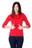 Beautiful young woman gesturing thumbs up. Royalty Free Stock Images