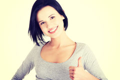 Beautiful young woman gesturing thumbs up. Royalty Free Stock Photos