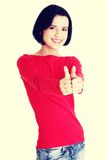 Beautiful young woman gesturing thumbs up. Stock Images