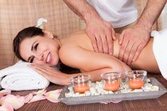 Beautiful young woman getting back massage Stock Image