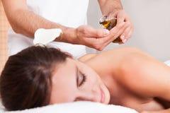 Beautiful young woman getting back massage Stock Photo