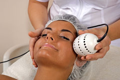 Beautiful young woman getting face massage. Beautiful young woman getting face massage in spa stock photo
