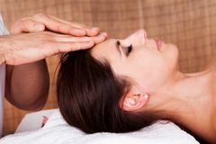 Beautiful young woman getting face massage Stock Images