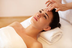 Beautiful Young Woman Getting a Face Treatment at Beauty Salon. Stock Images