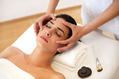 Beautiful Young Woman Getting a Face Treatment at Beauty Salon. Beautiful Young Woman Getting a Face Treatment at Beauty Salon Stock Photos