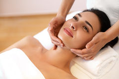 Beautiful Young Woman Getting a Face Treatment at Beauty Salon. Royalty Free Stock Image