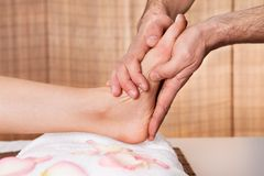 Beautiful young woman getting feet massage Stock Photos