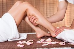 Beautiful young woman getting feet massage Royalty Free Stock Photos