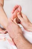 Beautiful young woman getting feet massage Stock Photo