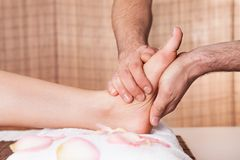 Beautiful young woman getting feet massage Royalty Free Stock Photography