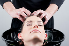 Beautiful young woman getting a hair wash Royalty Free Stock Image
