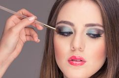 Beautiful young woman getting makeup done Royalty Free Stock Photo