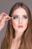 Beautiful young woman getting makeup done Royalty Free Stock Photography