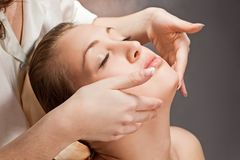 A beautiful young woman getting a massage Royalty Free Stock Image