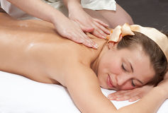 Beautiful young woman getting a massage Stock Photo