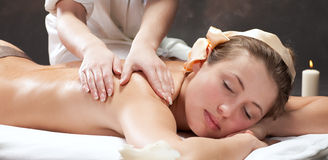 Beautiful young woman getting a massage Stock Images
