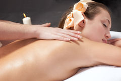 Beautiful young woman getting a massage Royalty Free Stock Photography