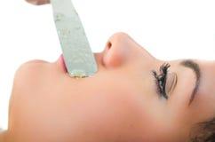 Beautiful young woman getting mustache waxing Stock Photo