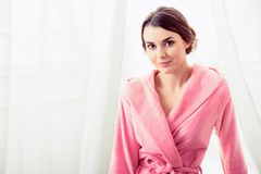 Beautiful young woman getting ready to take a bath Royalty Free Stock Images