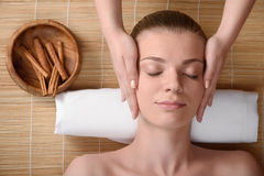 Beautiful young woman getting relaxing head Stock Images