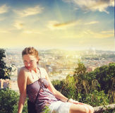 Beautiful young woman getting rest near St. Peter's square in Vatican, Rome Royalty Free Stock Photo