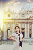 Beautiful young woman getting rest near St. Peter's square in Vatican, Rome Stock Photography