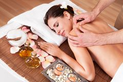 Beautiful young woman getting shoulder massage Stock Photos