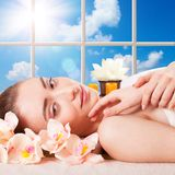 Beautiful young woman getting spa massage. Beautiful Young Woman Getting Massage Facial and Body in Spa Salon. Treatment Cosmetics Beauty Care Body Herbs royalty free stock photos
