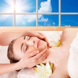 Beautiful young woman getting spa massage. Beautiful Young Woman Getting Massage Facial and Body in Spa Salon. Treatment Cosmetics Beauty Care Body Herbs royalty free stock photography