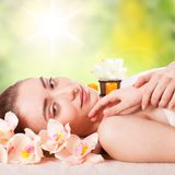 Beautiful young woman getting spa massage Stock Photos