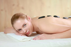 Beautiful young woman getting spa massage, lying Stock Image